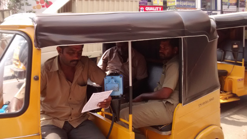 Auto Drivers read the pamphlet on Honda struggle